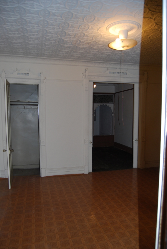 The closet on the left was built out and is  now the powder room.
